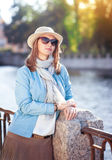Beautiful young woman in hat, sunglasses and scarf Royalty Free Stock Images