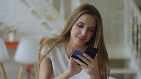 Beautiful young woman have online banking and shopping using smartphone and credit card at home stock footage