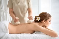 Beautiful young woman having back massage Stock Photos