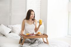 Free Beautiful Young Woman Having Breakfast On Bed At Home Royalty Free Stock Image - 151110936