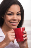 Beautiful young woman having coffee. Stock Images
