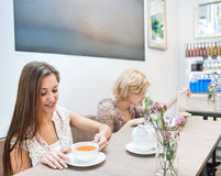 Beautiful young woman having coffee in cafe Stock Image