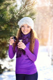 Beautiful young woman having a cup of tea in the winter sun Stock Photo