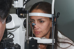 Beautiful young woman having eye test at the optometrist Royalty Free Stock Photo