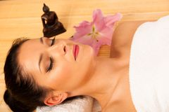 Beautiful young woman having a face massage in wellness studio -. Spa royalty free stock photo