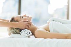 beautiful young woman having facial massage royalty free stock photo