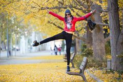 Beautiful young woman having fun in the autumn. Stock Photo