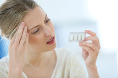Beautiful young woman having a headache Stock Photos