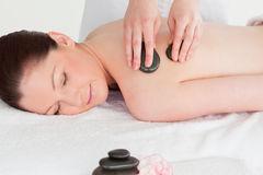 Beautiful young woman having a LaStone therapy Stock Image