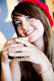 A beautiful young woman having lucnh in a cafe Royalty Free Stock Photos