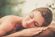 Beautiful young woman having massage in a spa salon Royalty Free Stock Images