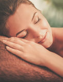 Beautiful young woman having massage in a spa salon Stock Images