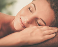 Beautiful young woman having massage in a spa salon Stock Photo
