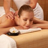 Beautiful young woman having a massage treatment in spa salon -. Wellness royalty free stock photos