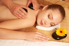 Beautiful young woman having a massage treatment in spa salon - wellness.  stock photography