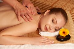 Beautiful young woman having a massage treatment in spa salon -. Wellness royalty free stock photo
