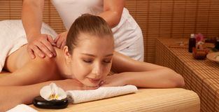 Beautiful young woman having a massage treatment in spa salon - wellness.  royalty free stock photo