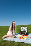 Beautiful young woman having a picnic Royalty Free Stock Photography