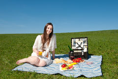 Beautiful young woman having a picnic Stock Photography