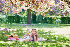 Beautiful young woman having picnic in blooming spring park Stock Images