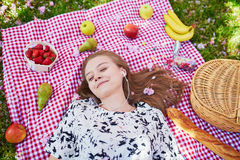 Beautiful young woman having picnic in park Stock Images