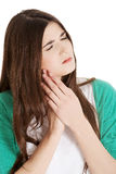 Beautiful young woman having toothache. Stock Photography