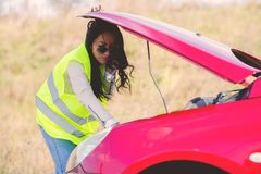Woman hawe vehicle breakdown. Beautiful young woman hawe vehicle breakdown Stock Photos