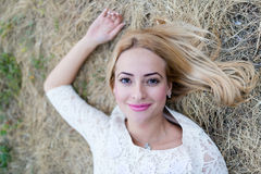 Beautiful young woman in the hay Stock Photo