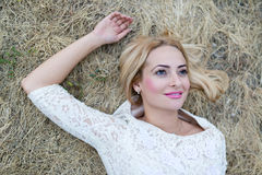 Beautiful young woman in the hay Stock Photography