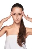 Beautiful young woman with headache touching her Royalty Free Stock Images