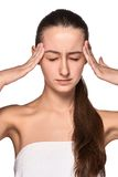 Beautiful young woman with headache touching her Royalty Free Stock Photography