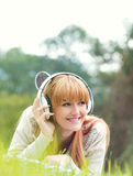 Beautiful young woman with headphones Royalty Free Stock Photos