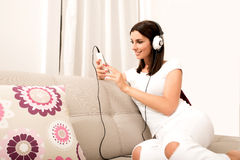 Beautiful young woman in headphones listening to music Stock Photography