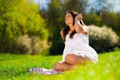 Beautiful Young Woman with Headphones Outdoors Stock Image
