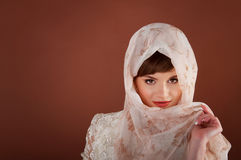 Beautiful young woman in headscarf. Muslim tradition. Royalty Free Stock Photo