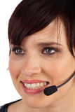 Beautiful Young Woman with Headset. Beautiful Young Female Phone Operator on a White Isolated Background Royalty Free Stock Photos