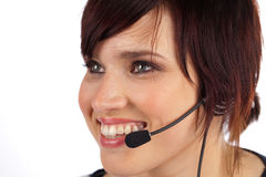 Beautiful Young Woman with Headset. Beautiful Young Female Phone Operator on a White Isolated Background Royalty Free Stock Photography