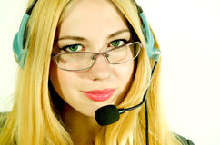 Beautiful young woman in a headset. Stock Image