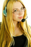 Beautiful young woman in a headset. Royalty Free Stock Photography