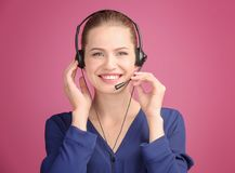 Beautiful young woman with headset. On color background stock photo