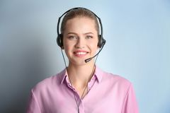 Beautiful young woman with headset. On color background royalty free stock photos