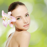 Beautiful young woman with health skin. And flower stock image