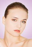 Beautiful young woman with healthy clean skin. Stock Photography