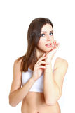 Beautiful young woman with healthy clean skin of the face - isol Royalty Free Stock Image