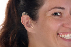 Beautiful young woman with hearing aid. Closeup shot royalty free stock image