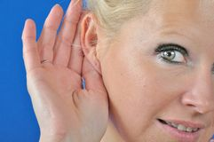A beautiful young woman hearing Royalty Free Stock Photography