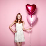 Beautiful young woman with heart shape air balloon Royalty Free Stock Images