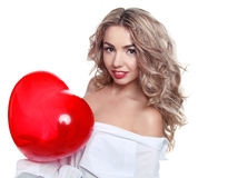 Beautiful young woman with heart-shaped balloon Royalty Free Stock Photo