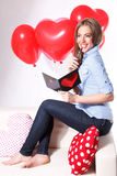 Beautiful young woman with heart shaped balloons Royalty Free Stock Photo