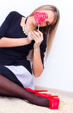 Beautiful young woman with heart shaped lollipop Stock Image